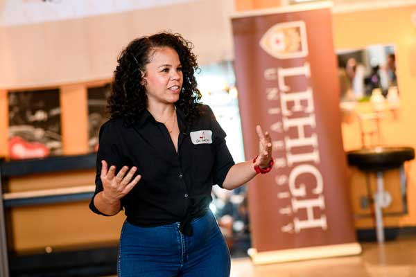 Patrice Banks '02 speaks to fellow Lehigh alumni and guests at her garage in Upper Darby, PA