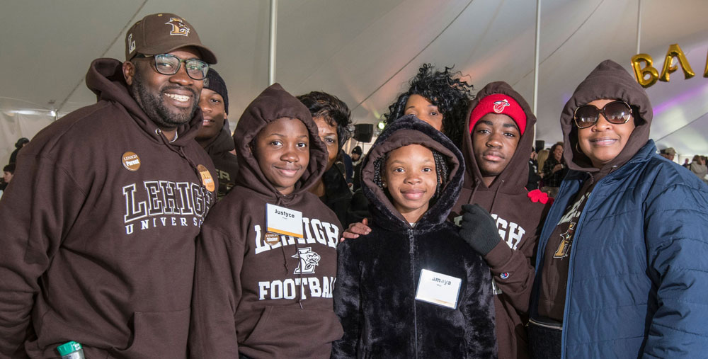 Family poses for a group photo during the Family Weekend tailgate.