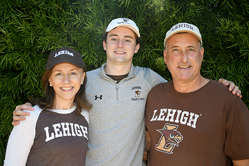 Jeff Fisher '22P and Amy Weaver '22P, trustee with their son, Matthew Fisher '22