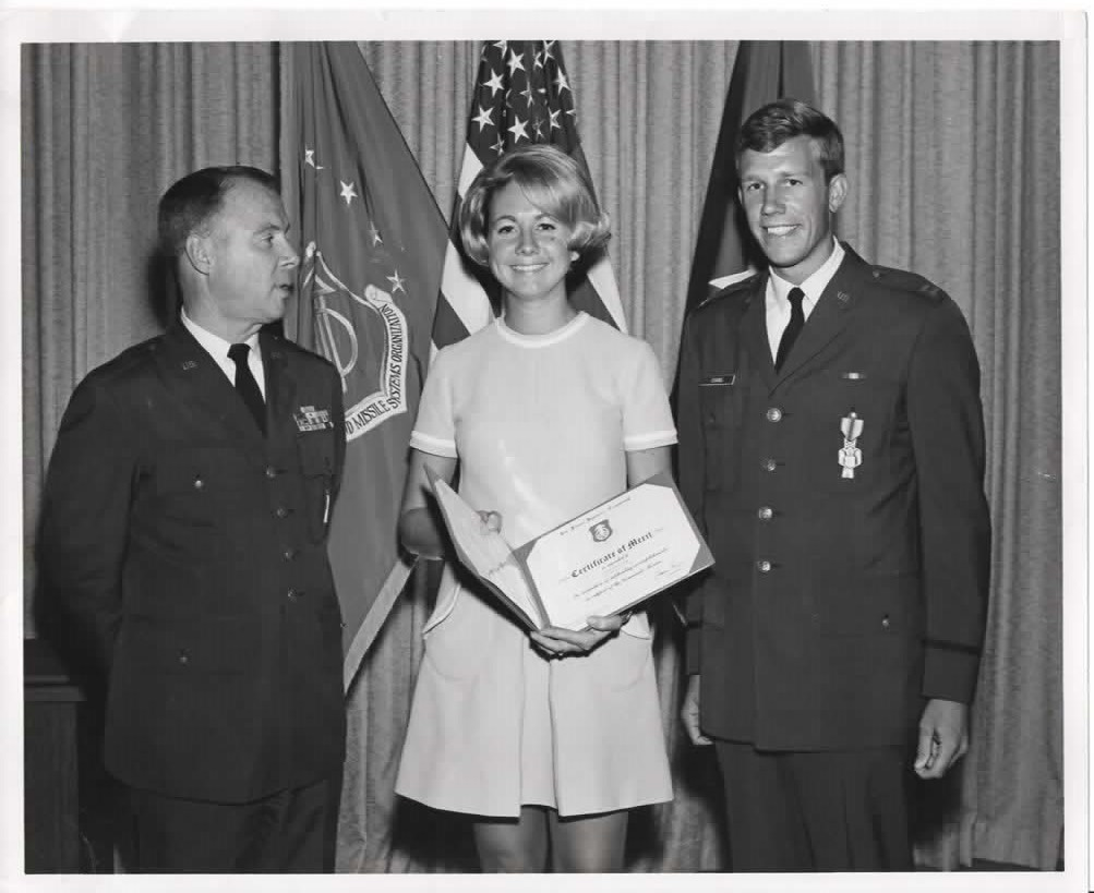Dave Evans '66 (right) and his wife, Rita, receiving an award from his commanding general in 1969.