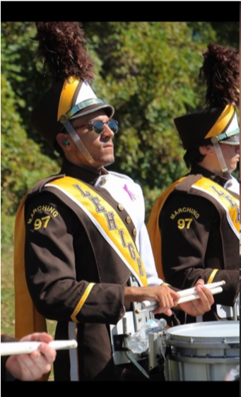 JP Villamar playing a snare drum as part of the Lehigh University Marching 97