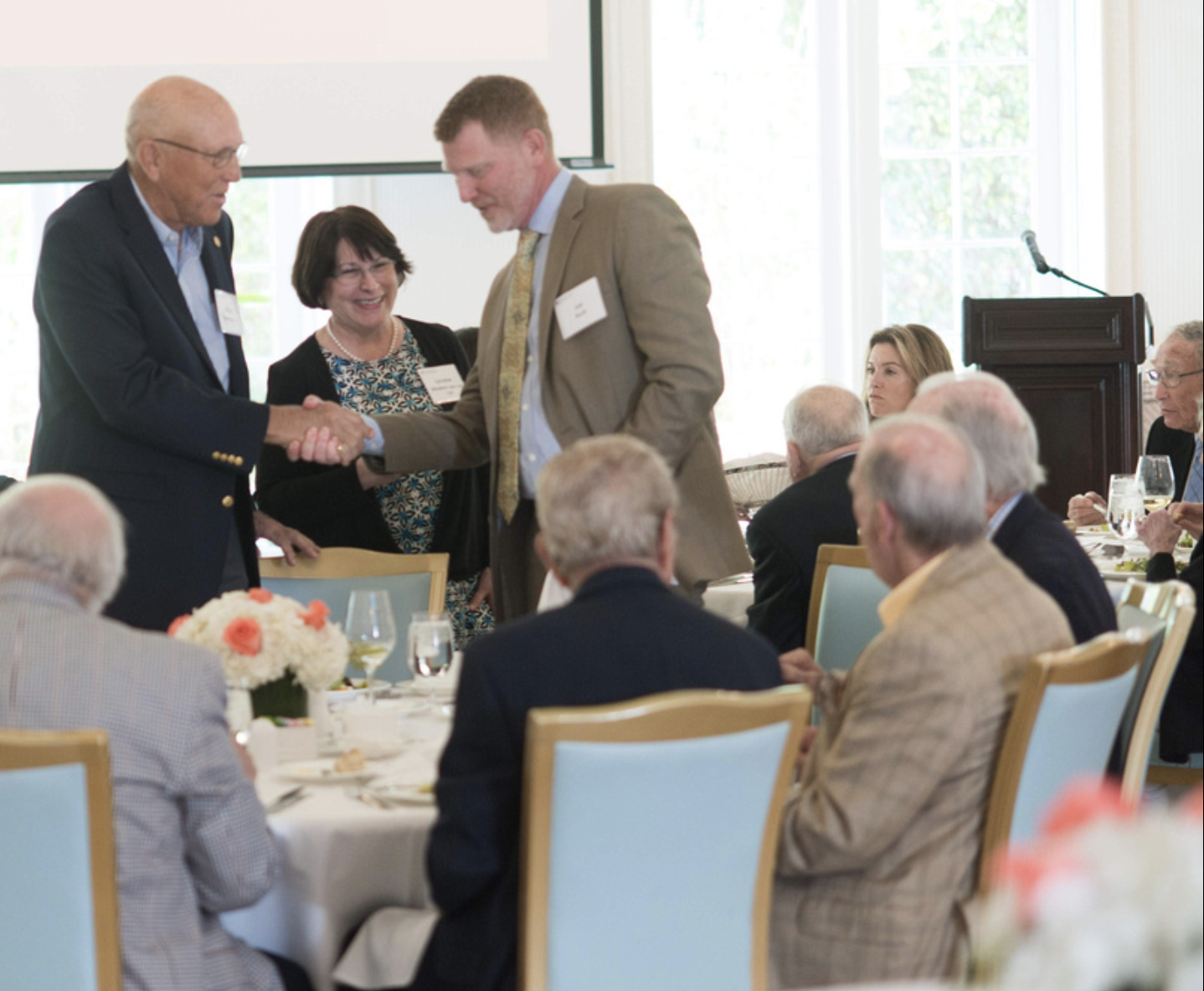 Richard Bradley '61 (left) was welcomed by Lorraine Wiedorn '84G '13P '17P, assistant vice president, planned giving, and Joe Buck, vice president, development and alumni relations, at the Tower Society event in Palm Beach, Florida.